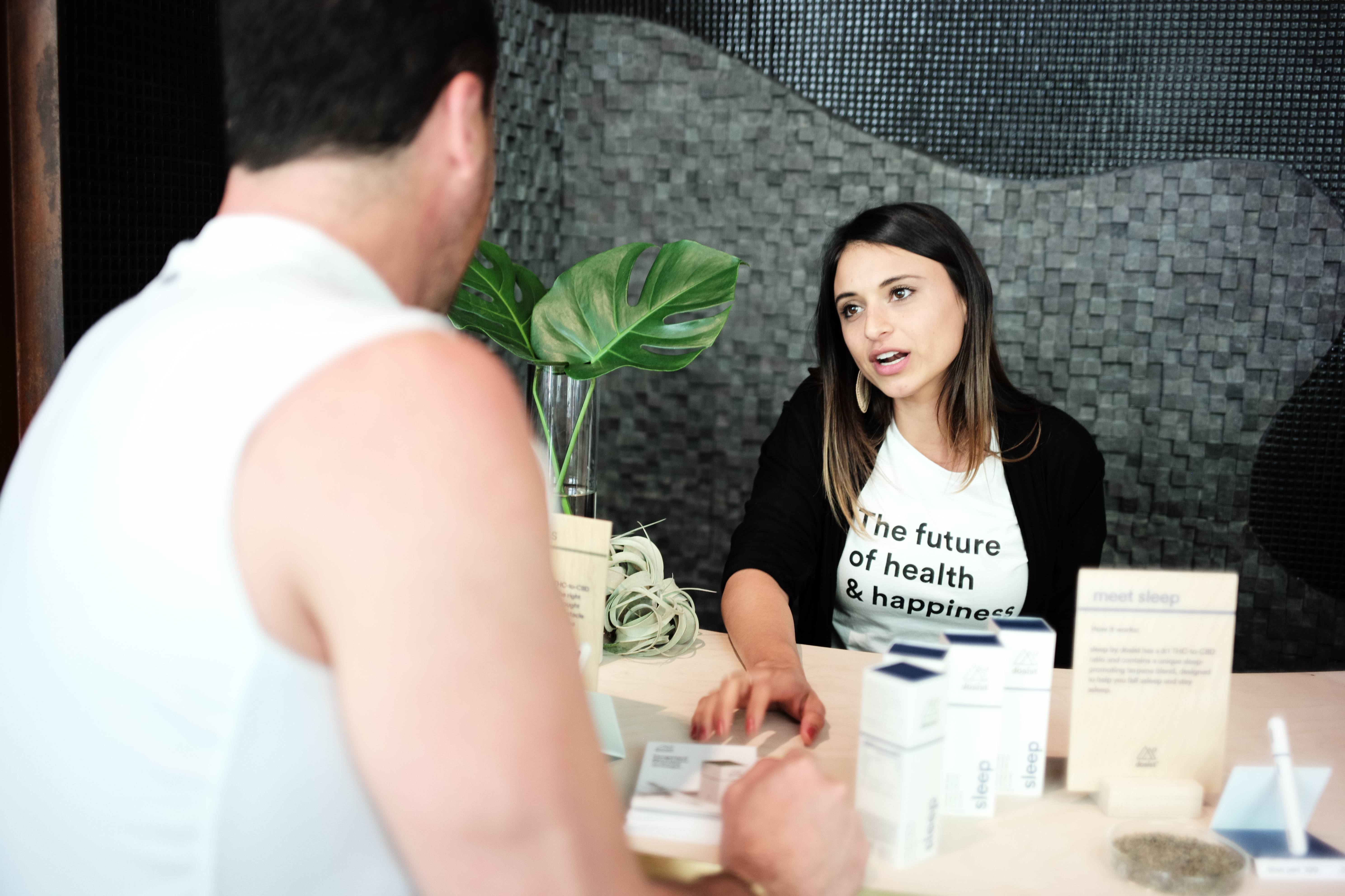 Concierge at dosist explaining benefits of products to male customer