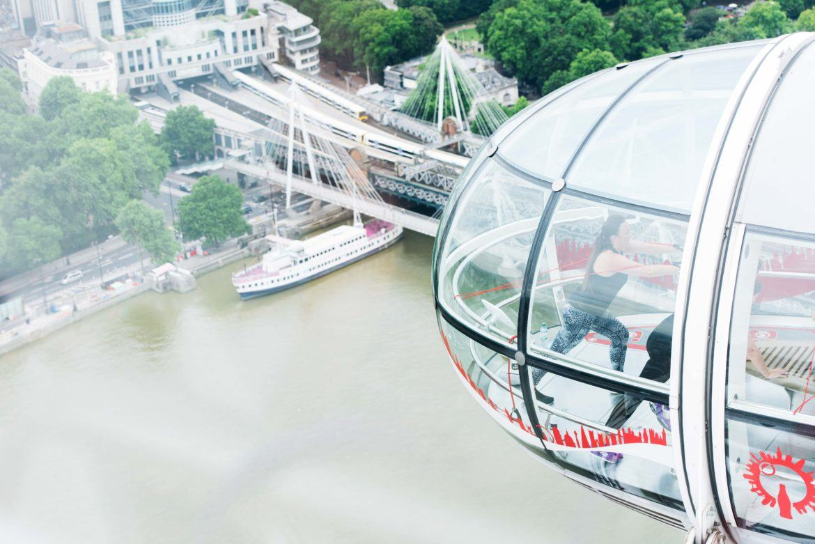 Outside view of London Eye pod with Barry's Bootcamp instructor teaching a class inside