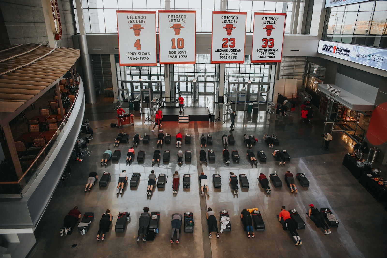 Overhead view of Barry's Bootcamp fitness class and Chicago Bulls banner in the United Center Atrium in Chicago